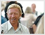 Boris Becker chats to guests at Wimbledon. He has won the Gentlemen's Singles Championship three times (1985, 1986 & 1989).